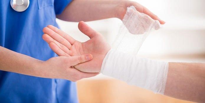 Nurse Bandaging Injured Man's Arm