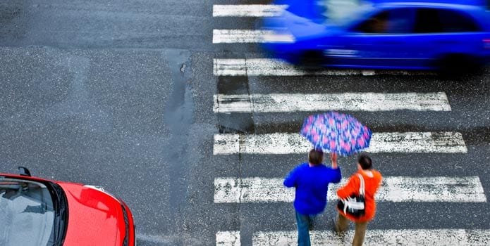 Pedestrians on Rainy Crosswalk